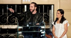 Nayib Bukele, the winner of El Salvador's presidential election, with his wife Gabriela de Bukele,   addresses   supporters in San Salvador on Sunday. Photograph: Jose Cabezas/Reuters