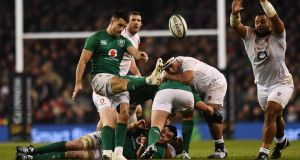 England's Billy Vunipola attempts to block a kick from Ireland's Conor Murray. Photograph: Clodagh Kilcoyne/Reuters