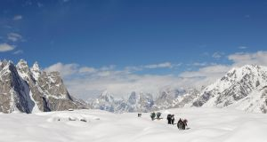 Trekkers and porters hike down the Baltoro glacier in the Karakoram mountain range in Pakistan. File photograph: Wolfgang Rattay/Reuters