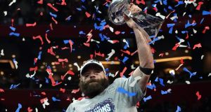 New England Patriots wide receiver Julian Edelman holds the trophy as he celebrates their Super Bowl win against the Los Angeles Rams at Mercedes-Benz Stadium in Atlanta, Georgia. Photograph:   Timothy A Clary/AFP/Getty Images