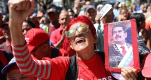 Chavistas participate  in an event to support President Nicolas Maduro, in Caracas, Venezuela on Monday. Photograph:  Cristian Hernandez/EPA