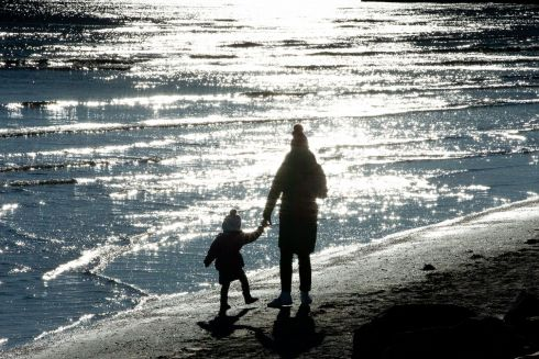 LONG SHADOWS, HIGH HOPES: A dazzling Sandymount Strand gets a few walkers on a day with a spring in its step. Photograph: Tom Honan/The Irish Times