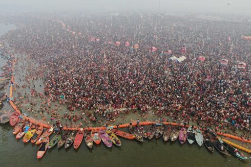 12 MILLION EXPECTED: Hindu devotees taking a holy dip at Sangam - the confluence of the Ganges, Yamuna and Saraswati rivers - for the Mauni Amavasya event in Allahabad, India. State authorities in Uttar Pradesh are expecting 12 million visitors to descend on Allahabad for the centuries-old festival.   Photograph: Uttar Pradesh PR Dept/AFP/Getty Images