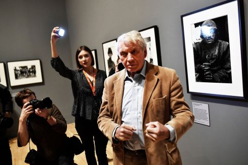 BOXING CLEVER: Renowned British photographer Don McCullin adopts a pugilistic pose during a light moment with  media personnel at a retrospective of his work at the Tate Britain gallery in London. Photograph: Dylan Martinez/Reuters