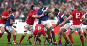 France's Sebastien Vahaamahina  is tackled during the  Six Nations match against Wales at the Stade De France. Photograph: David Davies/PA Wire