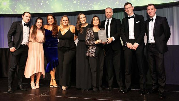 Margaret Colton, Head of Marketing, Dunnes Stores, presents the Best Sponsorship Team - Agency award to the TITAN Experience Team.