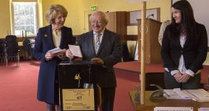 File photograph of President Michael D. Higgins and his wife Sabina voting in 2014. Photograph: Brenda Fitzsimons