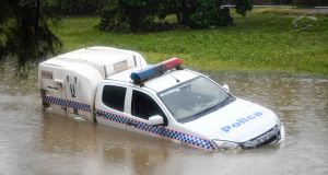 Residents of Townsville in north Queensland have been warned  that flooding has not yet reached its peak as torrential rain continues. Photograph:  Ian Hitchcock/Getty Images