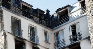 View of the apartment building where  a fire broke  in Paris.  Photograph: AP Photo/Christophe Ena