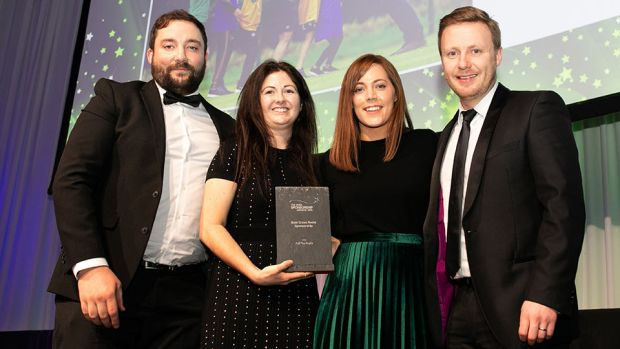 Sarah Rooney, Associate Director, Amárach Research, presents the Best Grass Roots Sponsorship award to Colm Finnegan, IRFU, Audrey O'Brien & Rob Hyland, Aldi Ireland.