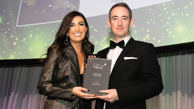 Conor Cullen, Sponsorship and Events Manager, Football Association of Ireland, presents the Rising Star in Sponsorship award to Pippa Doyle, Littlewoods Ireland.