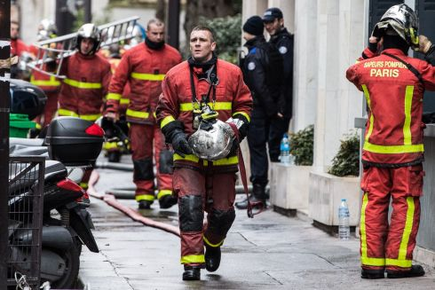 RAPID RESPONSE: Firefighters in action after a fire broke out at an apartment in the 16th district of western Paris, France. At least 10 people have been killed. Photograph: Christophe Petit Tesson/EPA
