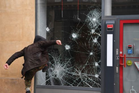 'DAY OF STRIKES': A person smashes the window of a bank a during a 'day of strikes' called by France's General Confederation of Labour worker's union in Paris. Photograph: Alain Jocard/AFP/Getty Images