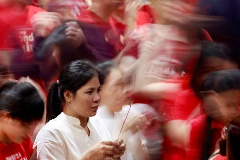 CELEBRATIONS: A woman lights an incense stick on Chinese Lunar New Year at a temple in Binondo, Manila, Philippines. Photograph: Eloisa Lopez/Reuters