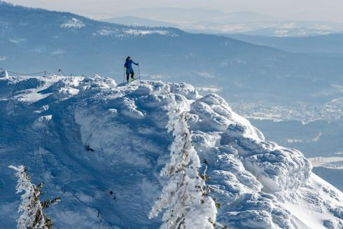 LONG WAY DOWN: A skier stands on the 1,456m high Grosser Arber mountain and looks over the snow covered landscape near Bayerisch Eisenstein, southern Germany. Photograph: Armin Weigel/AFP/Getty Images