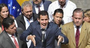 Venezuela's opposition leader and self-proclaimed acting president Juan Guaidó (C)  in Caracas. Photograph:  Yuri Cortez/AFP/Getty Images