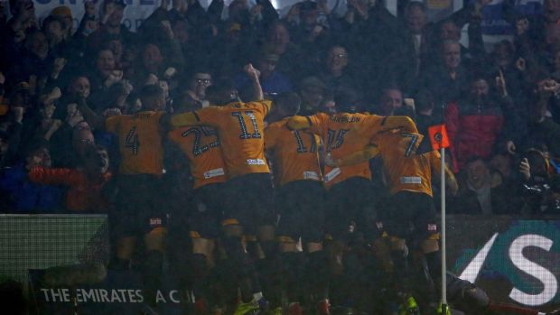 Newport players celebrate after Amond's goal. Photo: Geoff Caddick/Getty Images
