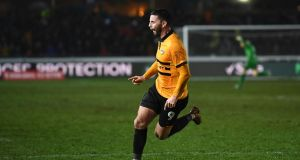 Pádraig Amond of Newport County celebrates after scoring his side's second goal during the FA Cup Fourth Round Replay against Middlesbrough at Rodney Parade. Photo: Stu Forster/Getty Images