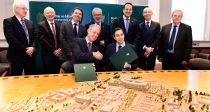 Minister for Health Simon Harris (front right) pictured in December 2017 at the signing of documents for the European Investment Bank loan to cover the cost of the national children's hospital. File photograph: Cyril Byrne/The Irish Times.