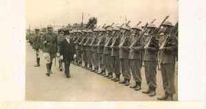 Jonathan Fennell's paternal grandfather accompanies President Sean T O'Kelly as he inspects an Irish Army guard of honour