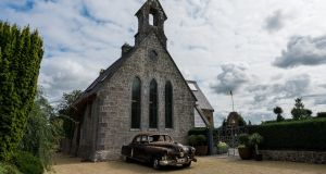 Des's Cadillac Fleetwood parked in front of the Kingstons' converted church.