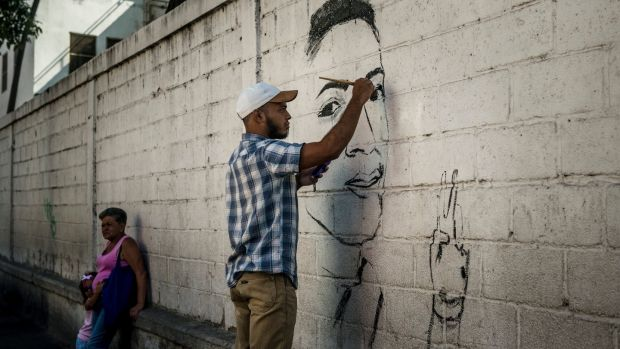 A mural paying tribute to Alixon Pisani, who was killed aged 19, in Catia, Caracas. Photograph: Meridith Kohut/The New York Times