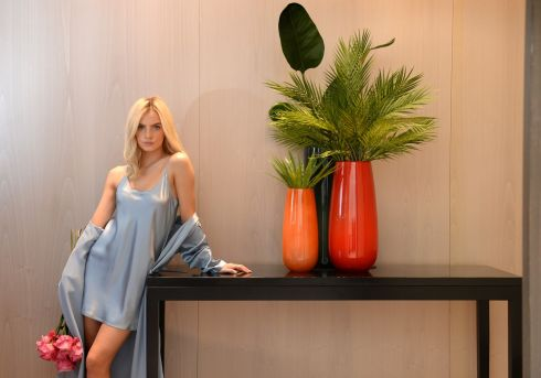 PRESENT COMPANY: Joanna Cooper wears a silk slip and a silk robe by La Perla, during a photocall for gift ideas from Brown Thomas for Valentine's Day. Photograph: Dara Mac Dónaill/The Irish Times