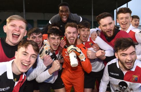 STUDENTS OF THE GAME: UCC players celebrate after winning their Rustlers IUFU Collingwood Cup final against University of Limerick, at Markets Field in Limerick. Photograph: Matt Browne/Sportsfile