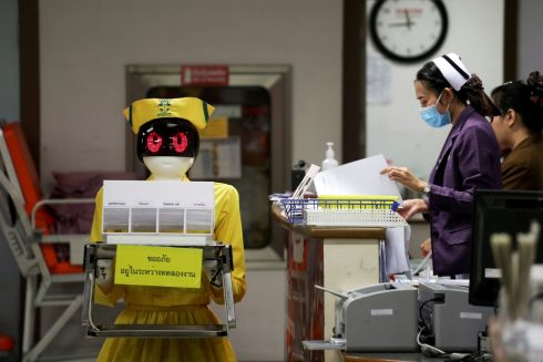 MEDICAL DEVICE: A robot wearing a nurse costume carries medical documents at Mongkutwattana General Hospital in Bangkok, Thailand. Photograph: Athit Perawongmetha/Reuters
