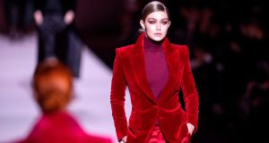 US model Gigi Hadid walks the runway during the Tom Ford fashion show at New York Fashion Week. Photograph: Johannes Eisele/AFP/Getty Images