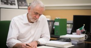 Labour leader Jeremy Corbyn signs a letter he has written to prime minister Theresa May laying out Labour's five Brexit demands before she went to Brussels on Thursday. Photograph: Stefan Rousseau/PA Wire