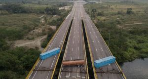 A gas tank and shipping containers obstructing  the Tienditas International Bridge near Venezuelan border to Cucúta in Colombia. Photographer: Ivan Valencia/Bloomberg