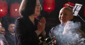 Taiwan's president Tsai Ing-wen (left) praying for peace at the Dharma Drum Mountain in New Taipei City, Taiwan on Monday. Photograph: Taiwan presidential office  handout/EPA