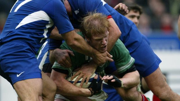 Paul O'Connell is tackled during Ireland's heavy defeat in Paris in 2004. Photograph: Billy Stickland/Inpho