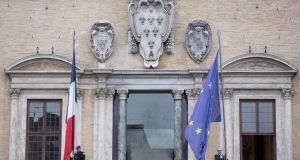 French policemen hold up French and EU flags on the facade of Farnese Palace, the French embassy in Rome. File photograph: Claudio Peri/EPA
