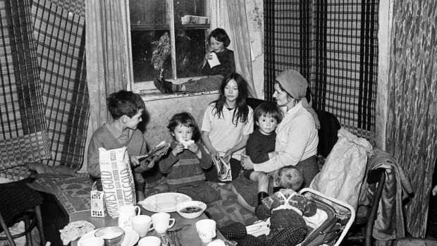 The Murphy family in a crumbling corporation tenement block on Dublin's Benburb street in 1968. Photograph: Getty Images