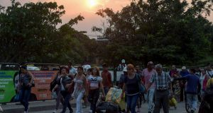 People cross the bridge on the border between Táchira in Venezuela and Cúcuta in Colombia. Photograph: Raul Arboleda/AFP/Getty Images