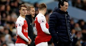 Arsenal  manager Unai Emery, right, expects Huddersfield  to press high rather and he accepts his team must be better against this type of approach. Photograph: Carl Recine/Action Images via Reuters