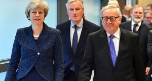 British prime minister Theresa May, EU chief Brexit negotiator Michel Barnier and European Commission president Jean-Claude Juncker at the European Commission headquarters in Brussels. Photograph: Geert Vanden Wijngaert/AP