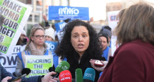 INMO's Phil Ní Sheaghdha with Nurses and Midwives at the entrance to the Coombe hospital.Photograph: Alan Betson / The Irish Times