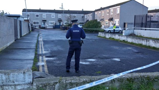 Gardaí at the scene Friday morning at Marigold Crescent, Darndale, where a man was shot at about 6.30am and later died in hospital. Photograph: Colin Keegan/ Collins