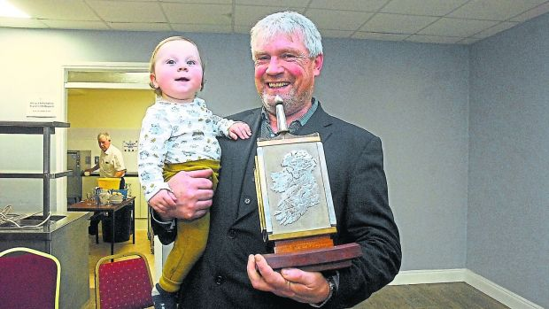 Séamus O'Rourke with his grandchild Fionn MacGowan (14 months) after receiving the Leitrim Guardian person of the year award. Photo: Leitrim Observer