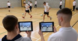 Fifth-year students record PE activities for video analysis as part of the new Leaving Cert PE subject in Castleknock Community College, Dublin. Photograph: Dara Mac Dónaill