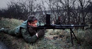 Border patrol: a wounded British soldier in Co Fermanagh in 1978. Photograph: Alex Bowie/Getty