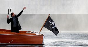 Roger Federer serves a ball towards the Jet D'Eau on a boat   in Geneva during a presentation ahead of the Laver Cup tournament that will take place   next September. Photograph: Getty Images