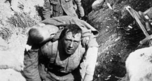 A frame from the documentary film 'The Battle of the Somme'. The soldier carrying a wounded comrade may have been Charlie Brennan, a Dubliner.