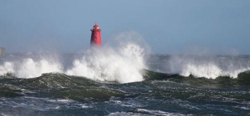 BEACON: Poolbeg Lighthouse stands against the crashing waves of Dublin Bay. Photograph Nick Bradshaw/The Irish Times