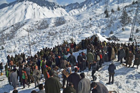 Local residents along with security personnel search for the bodies of 10 missing policemen after an avalanche hit a police post at Qazigund Jawahar Tunnel in Kulgam district, some 90 km from Srinagar, India on February 8th. Photograph: STR/AFP/Getty