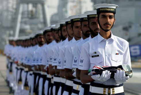 LINE UP: Pakistan navy servicemen carry national flags of participating countries during the opening ceremony of Pakistan Navy's Multinational Exercise AMAN-19, in Karachi, Pakistan February 8th. Photograph: Akhtar Soomro/Reuters