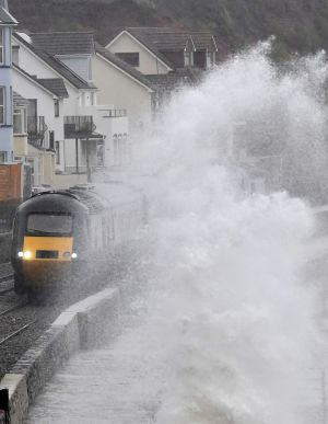 STORM ERIK: Large waves crash against Dawlish sea wall during Storm Erik as a train passes in southwest Britain on February 8th. Photograph: Toby Melville/Reuters